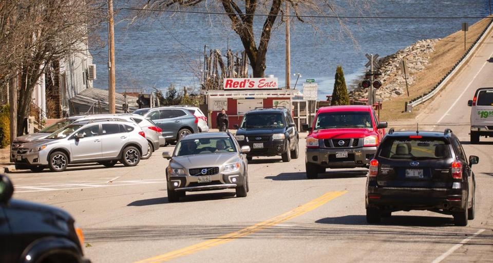 WISCASSET, ME - APRIL 5: Cars make their way along Rt 1, in the Maine town of Wiscasset, as cars, that were parked streetside, try to merge in. The Maine Department of Transportation's plan to eliminate on-street parking in the town, in order to widen the travel lanes and reduce bottlenecks during the summer tourist season, is being met by opposition of many business owners. (Carl D. Walsh for The Boston Globe)